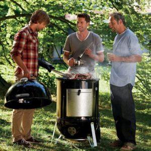 3 men discussing around a Weber Smokey Mountain Cooker