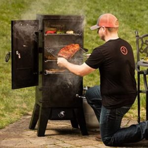 Man taking meat out of Cuisinart smoker