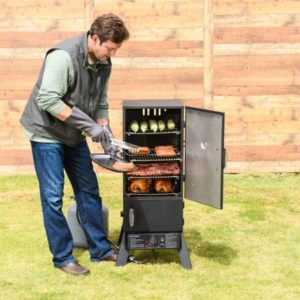 Man taking saussages out of a Masterbuilt smoker
