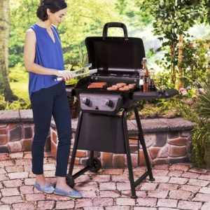 Woman grilling saussages on a Char-Broil Classic 280