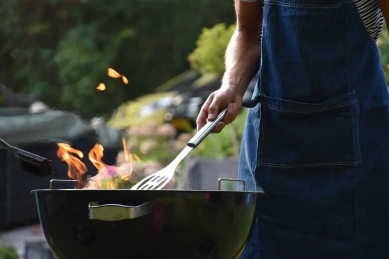 A man grilling some food
