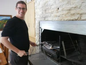 Benoit getting prepared to use a built-in grill
