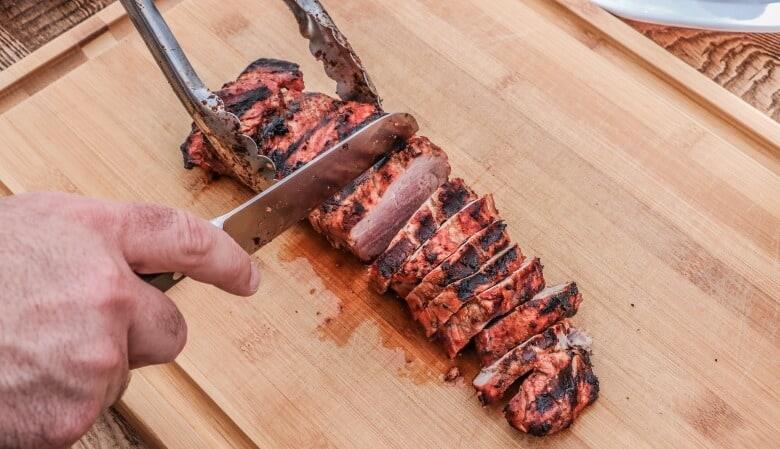 A man cutting beef ribs