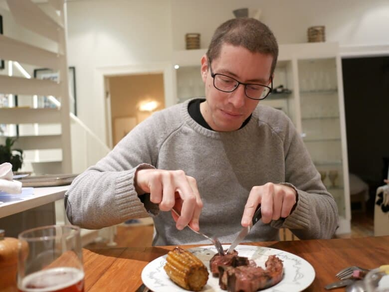 Benoit eating his smoked food