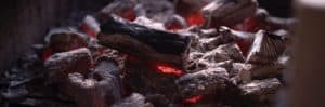 Burning lump charcoal